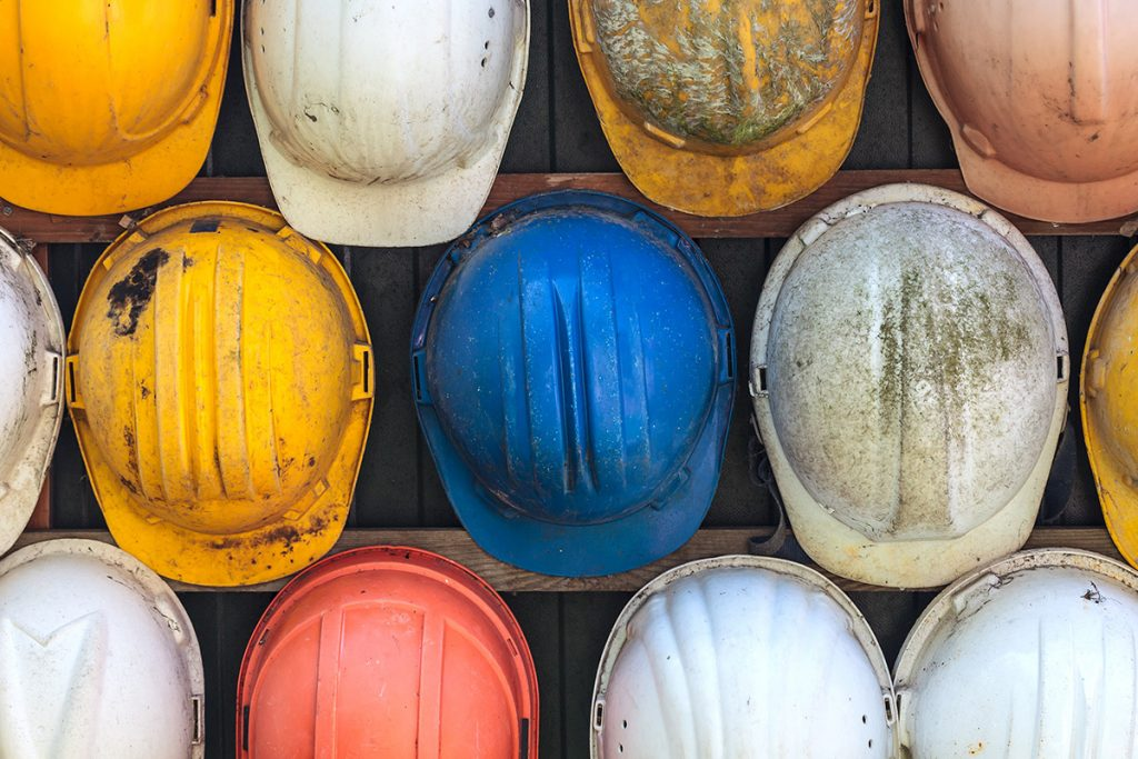 Image of old discarded construction hard hats